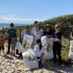 team ready for beach cleanup